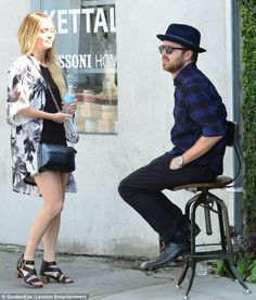Unimpressed: Lauren Parsekian does not look happy with hubby Aaron Paul who takes the only seat in sight on this West Hollywood street