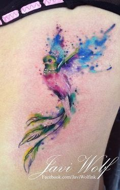Watercolor quetzal. Tattooed by Javi Wolf.  I adore the bright colors and the artistic form. It's perfect.