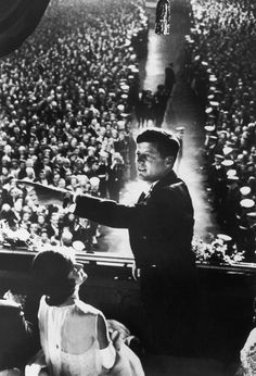 John and Jackie Kennedy in the Presidential Box overlooking the crowd during JFK's Inaugural Ball, 1961