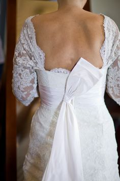 Lace and bow love: Custom design by Watters.