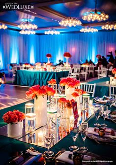 Stunning table with candles and centerpieces reflected on a mirrored table top