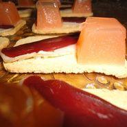 Canapés de jamón de pato y confitura de tomate