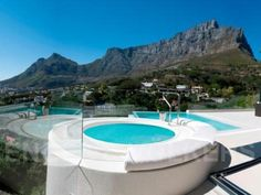 Prestigeous eco-home on the slopes of Signal Hill, Cape Town, overlooking Table Mountain -- price tag ZAR 27 million.