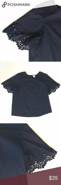 J. Crew Navy Eyelet Blouse Navy blouse by J. Crew with laser cut eyelet short sleeves. Button keyhole in back. Excellent used condition. Size medium.  •lowball offers will be declined •no trades •ask all questions before buying •unfair ratings from buyers are reported & buyer will be blocked - I don't misrepresent my products; what you see is exactly what you get & my prices are way more than fair. Please be kind as I always strive to be kind to you J. Crew Tops Blouses
