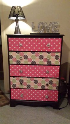 Re-Furbished Dresser I did for Baby Girl. sanded, primed & painted. Drawers covered in fabric.
