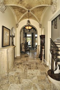 What a gorgeous foyer! Truly fascinating ceiling with that cross vault! #foyer #ceiling #crossvault