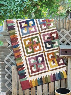 Celtic Family Ties quilt pattern: Mystic knots take on a new look in this pieced quilt that symbolizes the unity of celtic family ties. The quilt was designed by Maria Umhey.