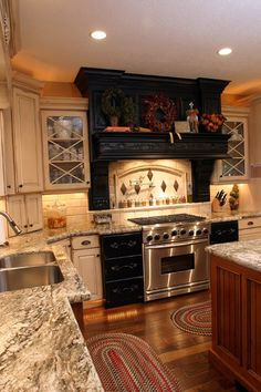 cream black and cherry cabinet mixture with hard wood and granite countertops!