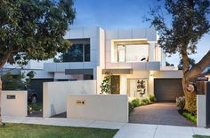 Gloss, glamour and great low maintenance living, this is streetfront style for a 5 star lifestyle. Stretched deep beyond water-feature front gardens with a...