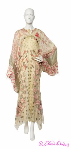Zandra Rhodes AW 1973 - Silk chiffon evening dress, the shape dictated by the design of the Shell Spiral print, with Reverse Lily used for the high round neckline with ties, the yoke and the long wide 'butterfly' sleeves; the join between the two patterns is traced by a line of beading.