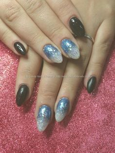 Black gel polish with blue and white glitter fade