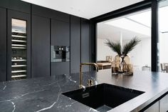 Bespoke Boform kitchen in black stained oak. Top in Nero Marquina marble. Mixer from Volas Exclusive Colour series. Integrated appliances from Gaggenau. Kitchen Room Design, Luxury Kitchen Design, Interior Design Kitchen, Kitchen Marble Top, Kitchen Taps, Marbel Kitchen, Kitchen Countertop Materials, Kitchen Countertops, Black Marble Countertops