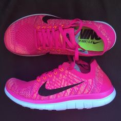 Nike Free 4.0 Flyknit Sneakers Woman's Nike free 4.0 Flyknit sneakers Pink Foil with hues of orange and a black swoosh Super comfy, sock like fit New with original box Size 7 Cheaper through ♏️  -I do have different sizes of this shoe unlisted. If you need a different size, let me know! Nike Shoes Sneakers