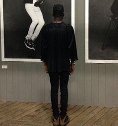 Theophilus London wearing Air Jordan IX Olive