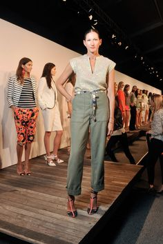 To show off J.Crew's Spring 2014 lineup, Lyons tucked a sparkly gold top into high-waisted pants and accessorized with t-strap heels and a casual belt.