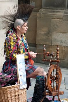 Spinning is so punk--spinning thread on The Royal Mile, Edinburgh, © Geoff Miller Photo