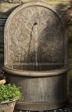 The classically inspired Corsini Water Fountain is as elegant as those found in quiet European courtyards.