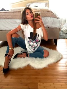 Cute tees, ripped jeans, and baby pumps are my fav!