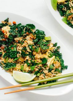 A vegetarian weeknight stir fry with sautéed kale, coconut flakes and rice. The dish is finished with Thai flavors like lime, cilantro and sriracha.