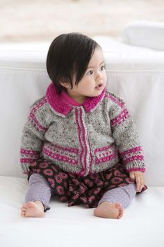 Adorable little baby sweater in sweet colors that mixes traditional with modern.