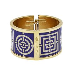 The iconic Florence Broadhurst print, Circles and Squares (navy) reproduced and meticulously finished with hand-polished enamel.  Brass based and hinged, the enamel bangle collection features 14ct gold plating and engraved signature logo.  Presented in a luxe...