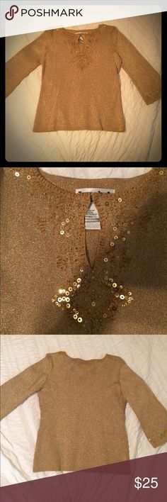 Gold sequined top 3/4 length gold sparkly knit top.  Pairs great with black pants or skirt. Extra large but fits more like a medium to large.  Excellent condition. Joseph A. Tops