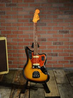 1965 Fender Jaguar with the original Owners Manual, original case and tremolo arm - in Sunburst finish. The guitar is completely original. The bridge pickup has been repaired, but did not need to be re-wound. The owners manual has the serial number noted on the first page (see photo). The red a...