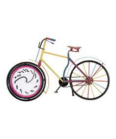 Surreal Bicycle Clock. Our stepson Nick bought this clock when we were all out shopping one day. Unique addition to a young persons home. Unisex colors.