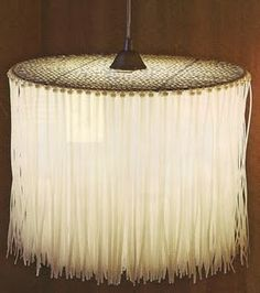 Light fixture made from a grill grate and plastic zip ties.