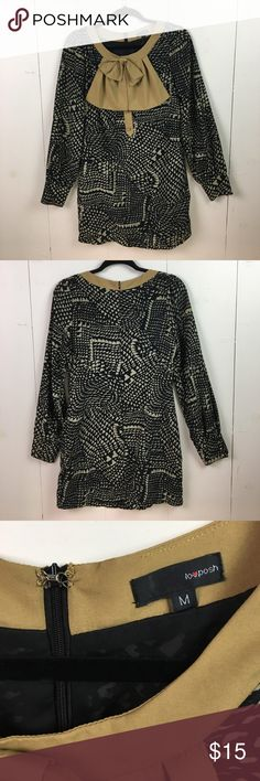 Tan & Black w/ Large Bow LovPosh Dress Size Small A statement bow and abstract print enhance the modern design of this cling-free shift dress. It looks great with boots in the Fall and Winter OR with nude flats in the spring! Long Sleeves. Dresses Long Sleeve