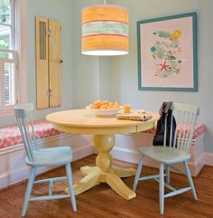 small-yet-comfy-dining-room-with-yellow-round-dining-table-corner-sofa-blue-wooden-chairs-and-pendant-lamp-with-blue-wall-color | Dweef.com