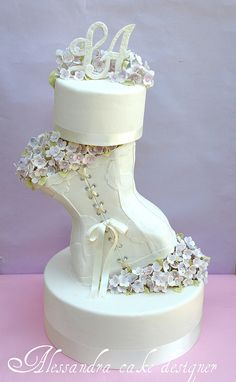 "wedding cake: without the top-piece, and with the grooms tux on front of the cake- to symbolice them beein ""one"""