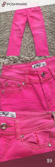 Pink jeans with tan  stitching Girls pink jeans with accent stitching and diamond like studs on front closing and pockets.  Great condition for school! Klip Jeans Bottoms Jeans