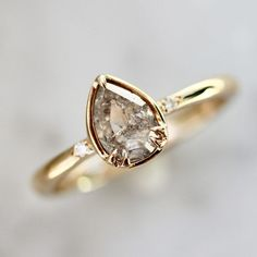 Avery Icey Pear Rose Cut Champagne Diamond Ring This ring is picture pear-fect! A glowing Rose Cut P Champagne Diamond Rings, Diamond Solitaire Rings, Diamond Engagement Rings, Affordable Diamond Rings, Bridal Ring Sets, Alternative Engagement Rings, Diamond Cuts, Pear Diamond, Jewelry Rings
