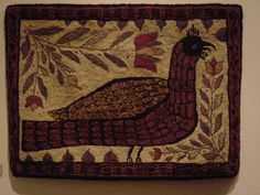 Neat fraktur inspired rug from past exhibit at Lancaster Quilt Museum.  Not sure who hooked it.