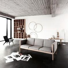 grey and minimal living room. Hoops on wall