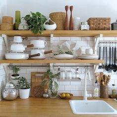 white kitchen butcher block open shelves vintage dansk kobenstyle subway tile