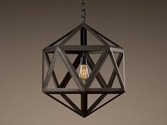 These steel polyhedron pendants at Restoration Hardware are really stunning and would be very dramatic grouped together in various sizes.