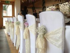 wedding chair sashes - Google Search Baby's breath tucked in each sash - nice touch.
