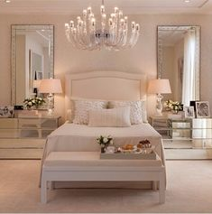 Love the tall mirrors over the side tables.