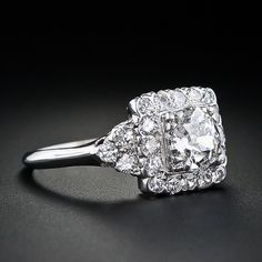 Looks like my cousin's engagement ring except her one has smaller diamonds around it in 2 or 3 rows