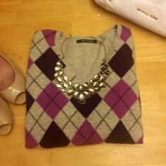 Cashmere Argyle Sweater Beautiful and soft 100% cashmere sweater.  Preloved but in good condition. No rips, tears, or stains. Minor pilling due to normal wear. Sweaters V-Necks