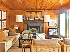 Great Grains ~ Varnished pine board clad the ceiling, walls, and floor of this lakeside cabin. A mixture of furniture styles and a variety of wood finishes allows the room to look as if it developed over time.