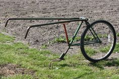 Home made cultivator made from an old bicycle frame and a 5 tyne cultivator.