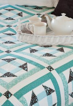 We love sea foam! This beautiful quilt is the perfect winter blanket for any space -- Sea foam Churn Dash Quilt.