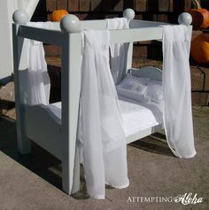 DIY doll canopy bed. Would love to do this for a newborn photoshoot. Maybe with and upside down table with trims added