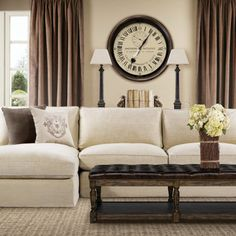 We like this linen sofa with chaise end for family room. Like that it's tailored but may lean towards modern a bit? Not sure if we want this exact Zin Home sofa. Like the color palette of room-creamy neutrals with brown/black accents!