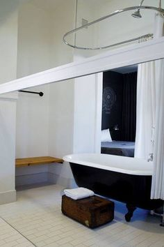 That built-in bench would be a really great use of our obscure L-shaped bathroom behind the tub!! Laundry basket underneath!