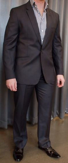 Ted Baker charcoal suit $1095 with patent leather shoes $295 from Gotstyle Menswear.