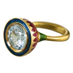 Alice Cicolini Jodhpur miniature petal aquamarine ring in gold, with a swirl of deep blue enamel